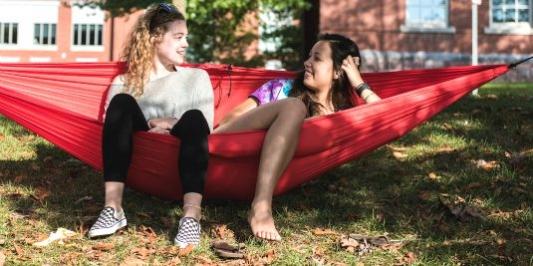 students relaxingin hammock