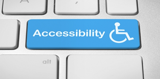A computer keyboard key with the word Accessibility next to the International Symbol of Access