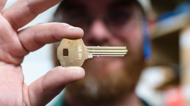 person holding room key