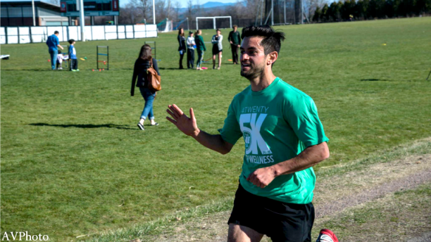 Runner crosses the finish line at UVM WE 4/20 5K for Wellness
