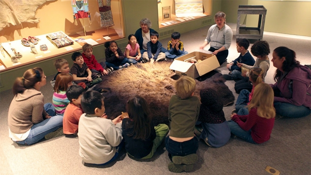 Students take part in an art exploration in the Museum's Native American gallery,