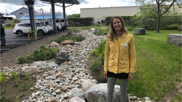 Dr Stephanie Hurley standing near her built stormwater project at the Echo Ctr, Burlington VT