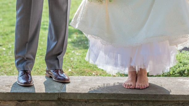 feet of bride and groom on wedding day