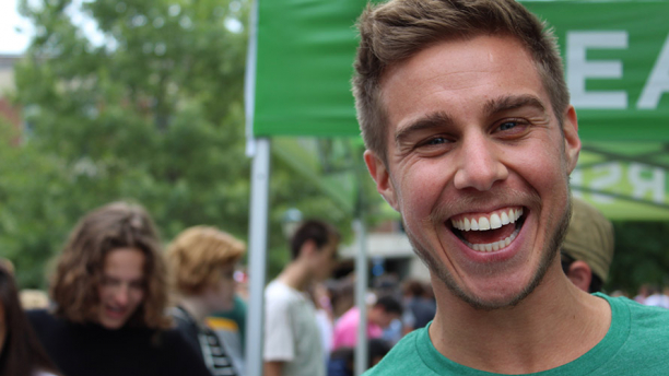 Living Well staff member Parker Holloway is smiling at the Class of 2023 picnic