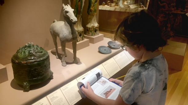 A young student takes part in a gallery tour and activity sheet.