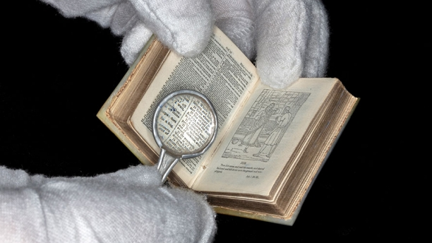 Miniature Bible with magnifying glass