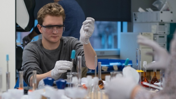 student conducting an experiment