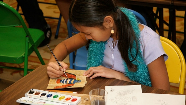 Student participating in a Museum art activity.