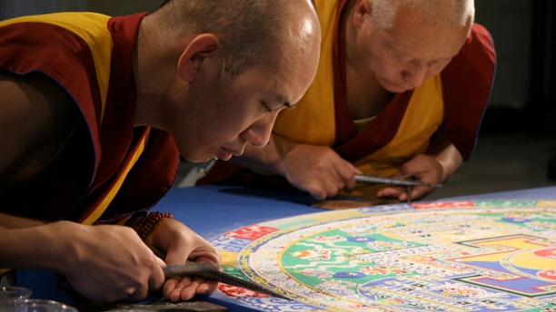 Buddhist monks creating a sand mandala
