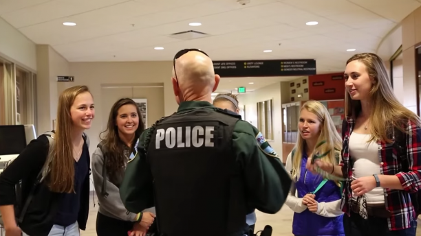 Officer Sioss engaging with students at the Davis Center.