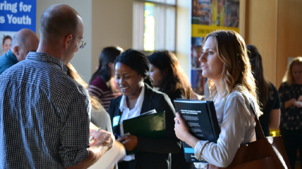 student speaking with a recruiter at a career fair
