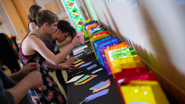 students writing notes at Rainbow Graduation