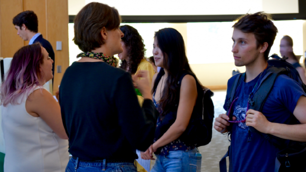 students talking to staff at a career-related event