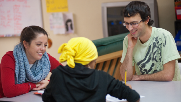 2 students tutoring at a youth center
