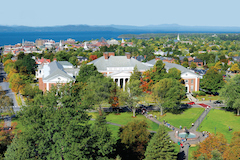 Aerial view of UVM campus, Burlington, Lake Champlain, and the Adirondak Mountains.