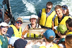 Ellen Marsden with students and fish on Melosira