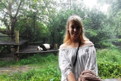 A student visits a panda while studying abroad
