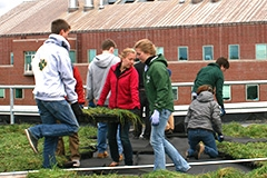 Students work on the Aiken Center green roof