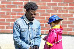 Male black student with child at UVM Campus Childrens School