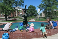 Children outside at a fountain