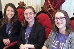 three female CESS students at the Vermont Statehouse