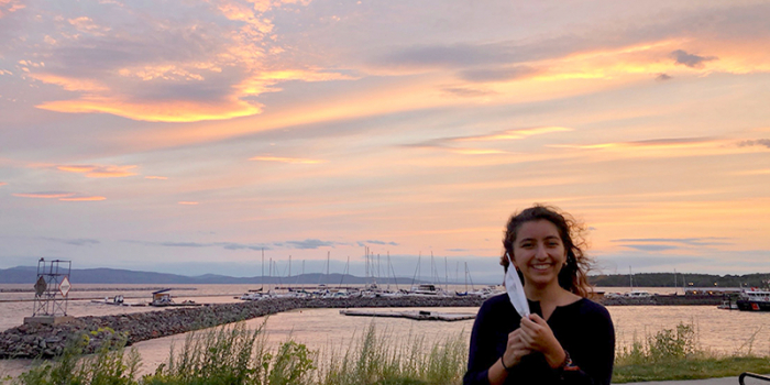 Julia LanzDuret-Hernandez at the waterfront in Burlington, Vermont at sunset.