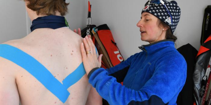 Karen Westervelt assists an athlete