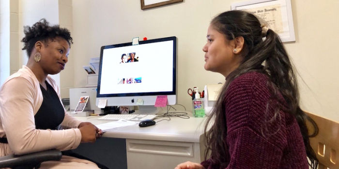 Briana Martin helping a student in her office at UVM.