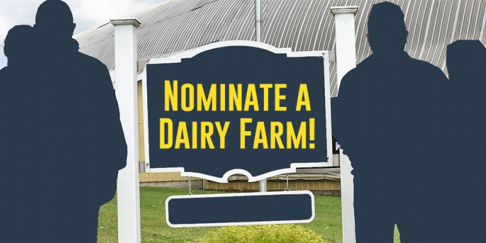 """Farm with silhouetted farmers and sign saying """"nominate a dairy farm!"""""""