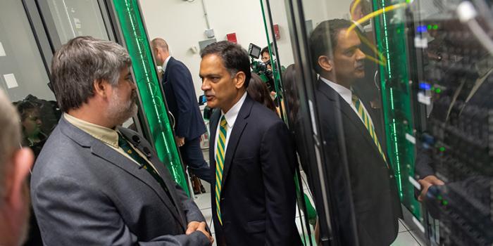 UVM president Garimella speaks with staff inside the VACC