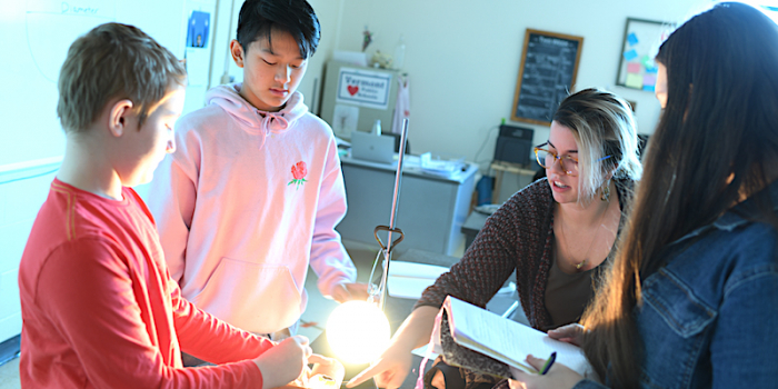 Erica Indiano leading a hands-on activity with students at Hunt Middle School in Burlington.