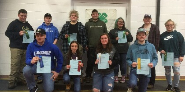 Twelve senior 4-H students who competed in the quiz bowl.