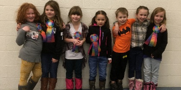 Seven children who participated in the horse quiz bowl