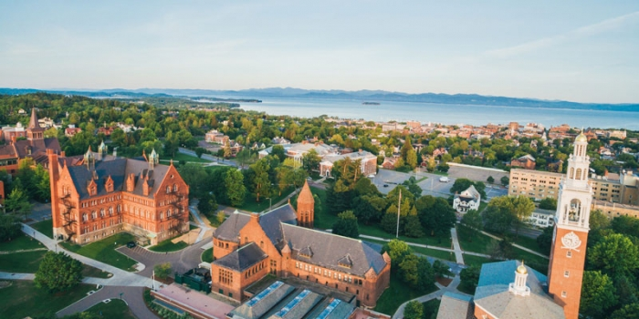 aerial view of the University of Vermont's historic campus, Lake Champlain and the Adirondack mountains. UVM