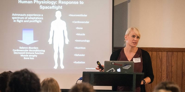 Kate Rubins presents a slide on the physiological response to spaceflight
