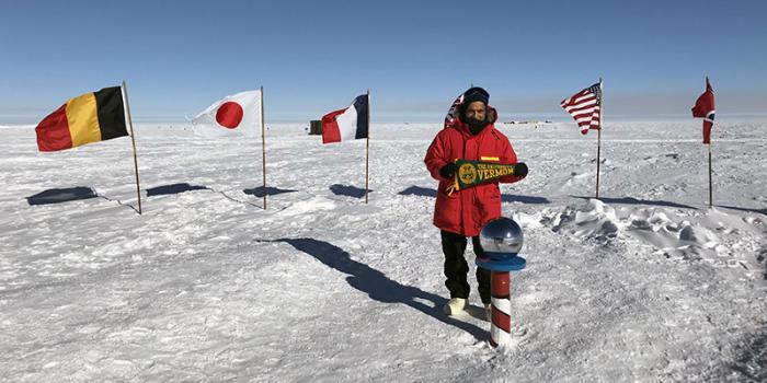 UVM President Suresh Garimella holds UVM pennant on South Pole
