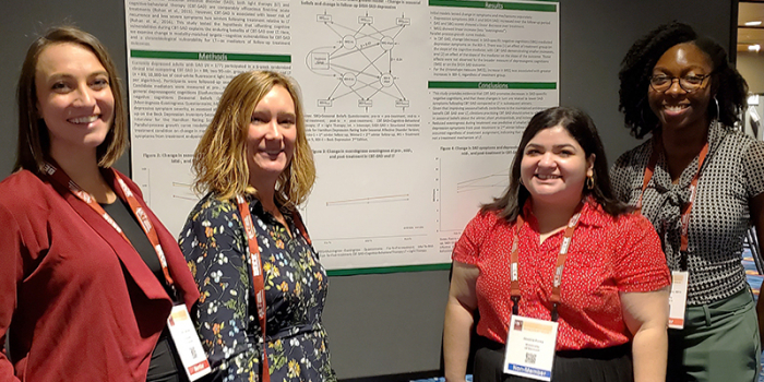 Presenting research at the Association for Behavioral and Cognitive Therapies (ABCT) annual convention in Atlanta November, 2019. Left to right: Julia Camuso (fellow Rohan lab graduate student), Kelly Rohan, Jessica Perez, Praise Iyiewuare