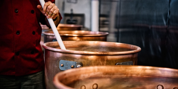 Stirring caramel in vats