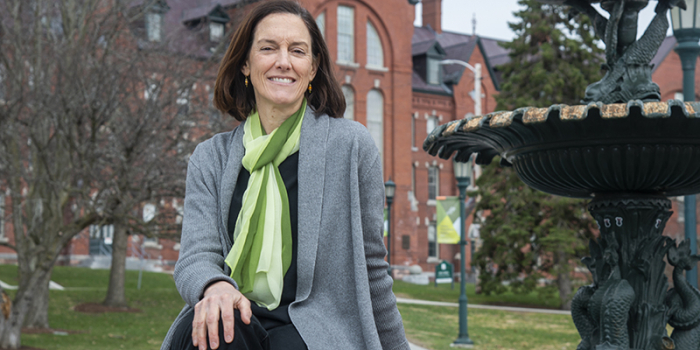 Alice Fothergill siting next to the fountain on the UVM green