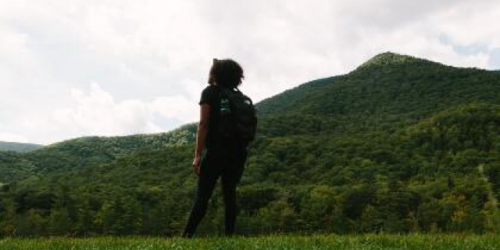 Teen girl overlooking mountain