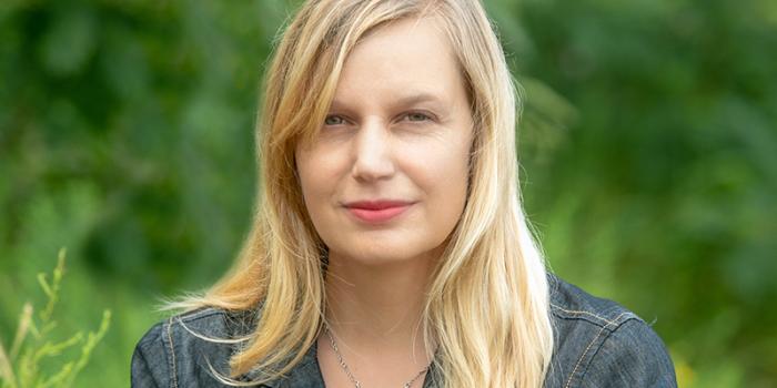 Maria Hummel headshot in an outdoor setting