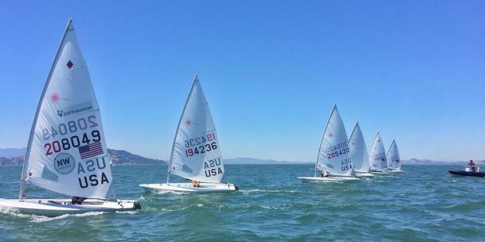 U.S. Sailing Team sailboats lined up in the San Francisco Bay.