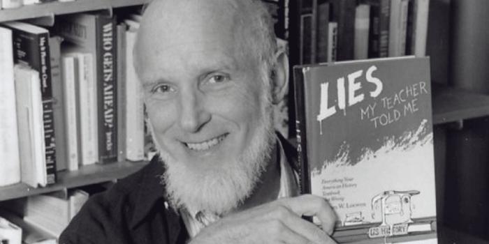 "James Loewen holding his book, ""Lies My Teacher Told Me"""