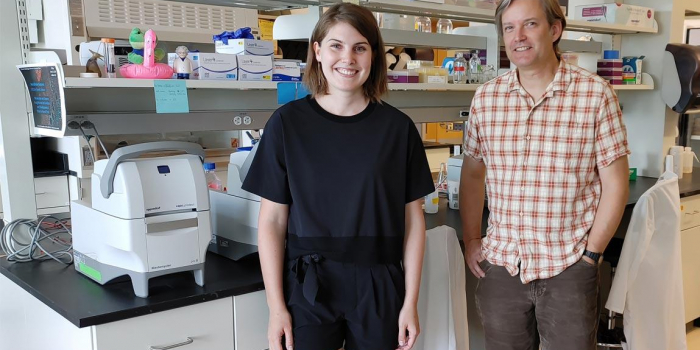 Brittany Verrico and Steve Keller standing next to a lab bench in the Keller Lab.