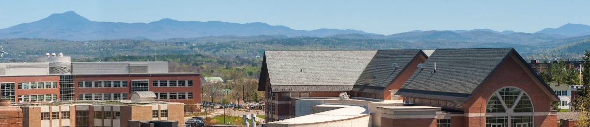 Central Campus in Spring with Camels Hump in the background