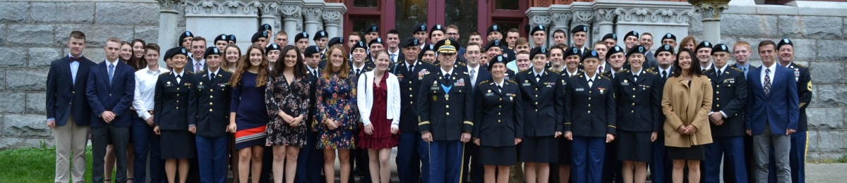 Green Mountain Battalion Cadre, Cadets, and Students pose in front of Williams Hall.