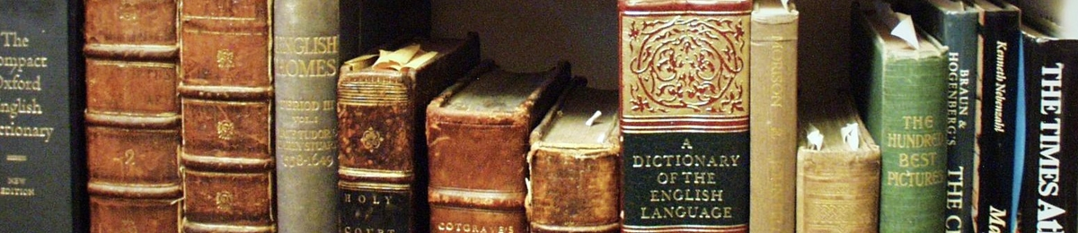 A row of old books including a dictionary of the english language