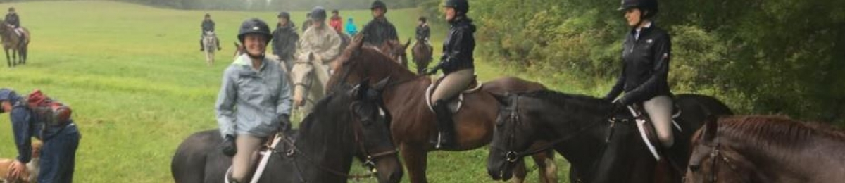 A group of students participating in a mounted hunting exercise