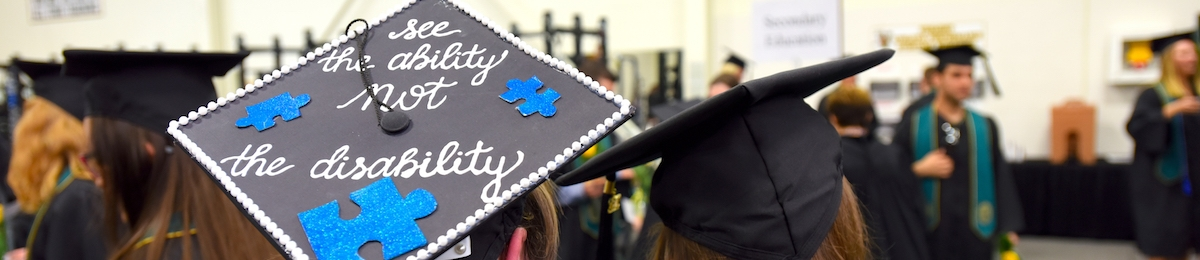 "Student mortarboard at graduation reading ""see the ability not disability""."