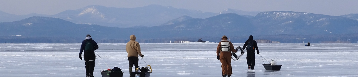 Graduate students doing field work on frozen lake